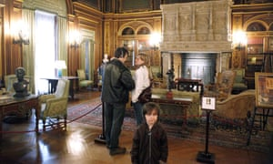 Visitors view the library during an audio-guided tour of the Breakers, a legendary 70-room summer estate.