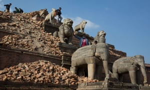 Nepalese visitors walk on ruins near the Nyatapola temple in Bhaktapur. The temple itself survived the earthquake.