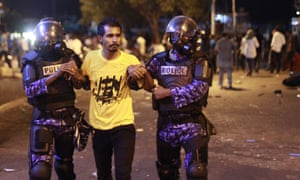 Police detain an opposition supporter during a protest on Friday demanding resignation of president Yameen Abdul Gayoom.