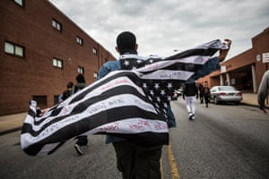 Protesters march through the streets in support of Maryland state attorney Marilyn Mosby's announcement that charges would be filed against Baltimore police officers in the death of Freddie Gray. Gray died in police custody after being arrested on April 12, 2015.