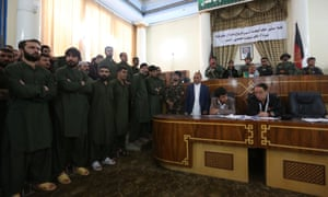 Defendants, left, on trial at Kabul primary court on Saturday.