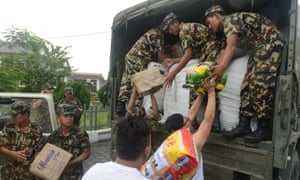 Nepalese soldiers load relief aid from residents of Sikkim, India, at Kakarvitta on Saturday.