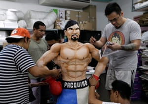 Filipino bakers put finishing touches to a Manny Pacquiao life-sized cake in Quezon city, east of Manila. The cake as a tribute to the Filipino Boxing icon.