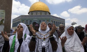 Palestinian women take part in Friday prayers during  Ramadan at Al-Aqsa mosque compound in Jerusalem.