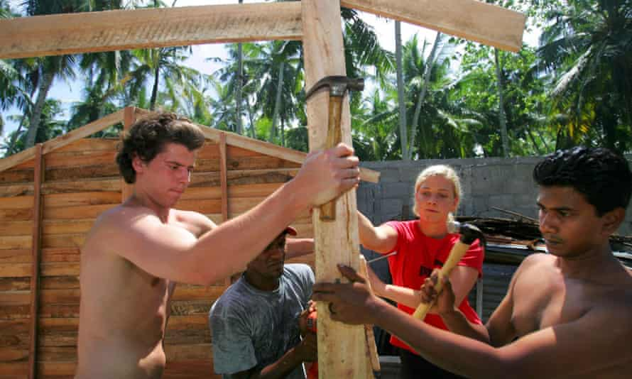 A team of foreign volunteers and Sri Lankan workers put up a transitional house for a Tsunami affected family in 2005.