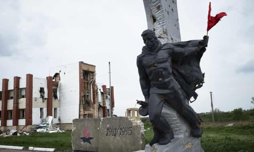 A red flag allegedly placed by pro-Russian rebels on a war memorial in Nikishyne, Ukraine.