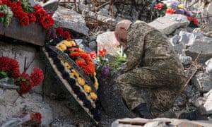 A separatist rebel visits a memorial during heavy fighting between Ukrainian army and separatist rebels 80km from Donetsk, Ukraine.