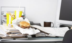 Fast food at workplace desk