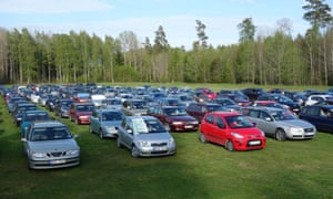 Cars line up for a game of drive-in bingo in a Swedish field.