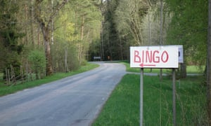 A bingo sign shows the way to a game site from a country road.