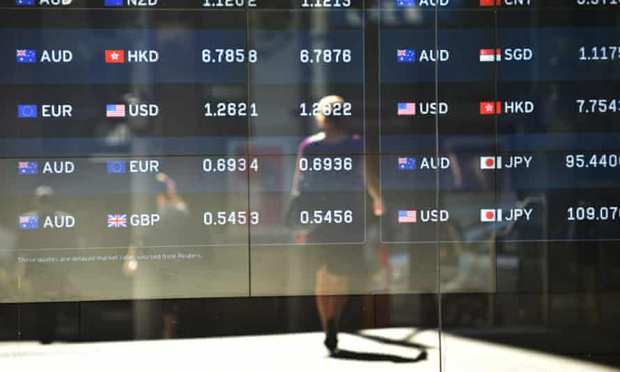 Foreign currency prices on display at a bank on a street in Sydney.
