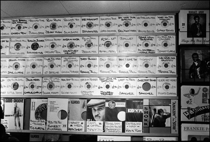 Reggae record sleeves on the wall at Dub Vendor, Clapham Junction, London, 1988