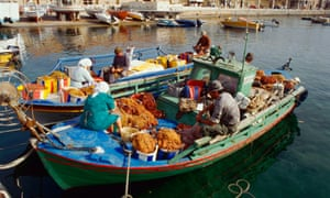 Island life: fishermen and women in the harbour at Paphos.