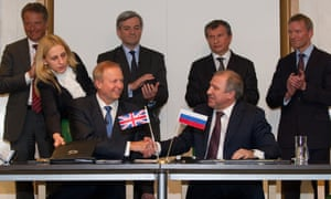 Oil giant BP Chief Executive Bob Dudley (seated L) shakes hands with state-run Russian firm Rosneft   s President Eduard Khudainatov (R) after signing an agreement to form a global and arctic strategic alliance at the BP headquarters in central London, on January 14, 2011. The agreement creates the first major equity-linked partnership between a national and international oil company.