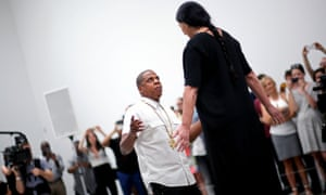 Jay Z dances with the Marina Abramovic at the Pace Gallery.