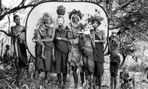 A group of Suri women with lip plates, headdresses and body paint