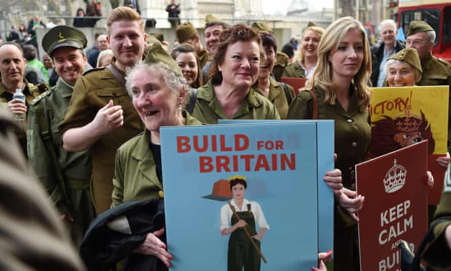 Demonstrators wearing WWII uniforms protest at a Homes for Britain rally in London