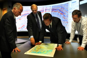 Prime Minister David Cameron (2nd right) with Regional President Trevor Garlick (left) BP Chief Executive Bob Dudley (2nd left) and Simon Richardson (right) Clair Reservoir Team Leader as they view an exploration map at BP North Sea Headquarters in Aberdeen.