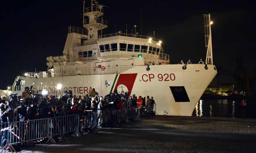 Italian coastguard ship Bruno Gregoretti, carrying survivors of the boat that overturned off the coast of Libya, arrives at Catania on 20 April.