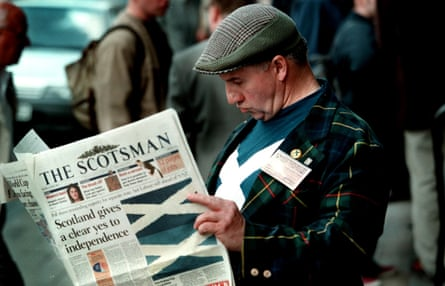 An SNP delegate reads the Scotsman on his way in to SNP special conference in Perth in 1998.