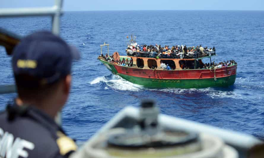 A French navy ship rescuing 297 migrants aboard a fishing boat in the Mediterranean earlier this week.