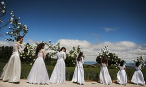 Teenagers dressed in bridal white surrounded by flowers take part in the Hundred Maidens pilgimage, in Sorzano, northern Spain, in honour of spring, the fertility of women and the Virgin Mary