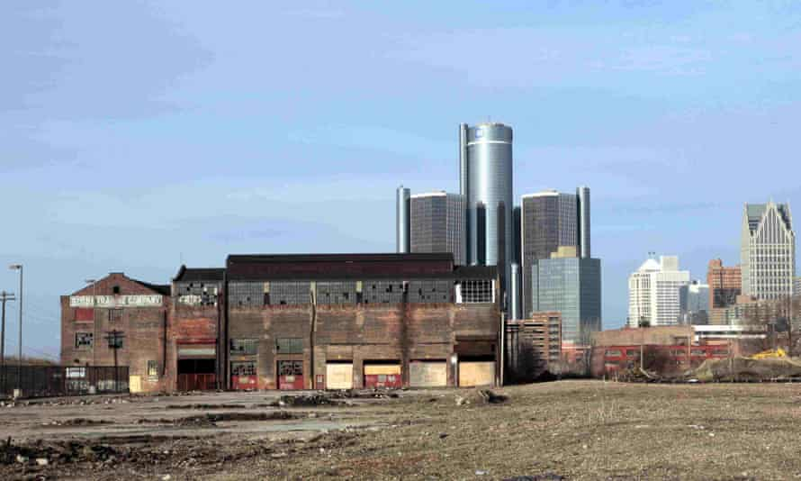 The Renaissance Center shines behind a dilapidated Detroit warehouse in 2009.