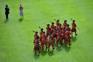 Yeomen of the Guard march during a garden party held at Buckingham Palace inl London