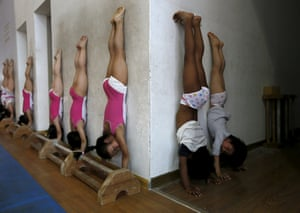 Students practise in the gymnastics hall at a sports school in Jiaxing, Zhejiang province, China