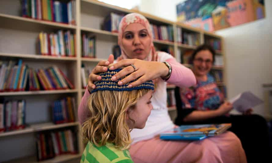 Alia Tunisi with a student at the Hand in Hand Arab Jewish bilingual school in Jerusalem