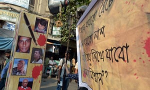 A  poster with pictures of the murdered Bangladeshi bloggers at a demonstration in Kolkata, India, on May 16.