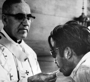 Archbishop Oscar Romero offers the host wafer during a mass in San Salvador in 1980.