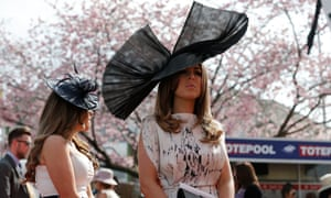Big hats go on display during Ladies' Day at the Grand National last month.