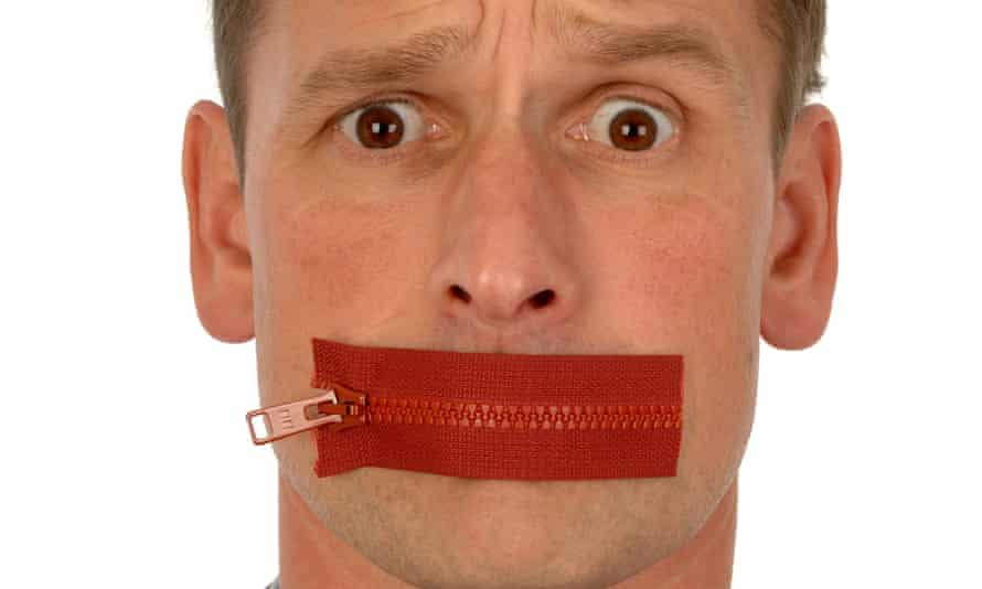 Man with a zip across his mouth. Image shot 09/2005.