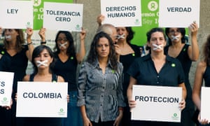 Colombian journalist Jineth Bedoya Lima (centre) takes part in a silent rally in Madrid.