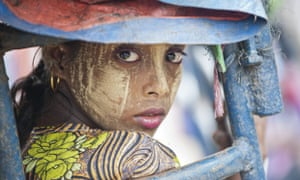 An ethnic Rohingya Muslim woman looking back as she rides a tuk tuk near a camp set up outside the city of Sittwe in Burma's Rakhine state