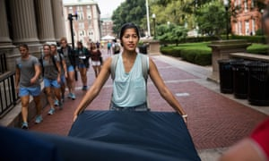Emma Sulkowicz carrying the mattress around campus. The protest is also doubling as her senior thesis project.