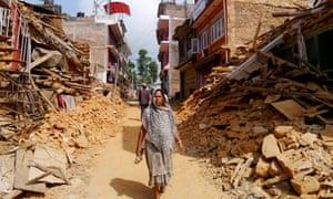 A woman walks along the ruined streets of Chautara municipality, Sindhupalchok district.