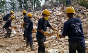 Workers clear the ruins of a government building in Chautara municipality, where nearly 3,500 people were killed and 4,000 injured in the Nepal earhquakes.