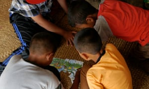 Boys in the Nepalese village of Chautara do a jigsaw puzzle made from cut-up calendars in a child-friendly space run by the youth NGO Restless Development.