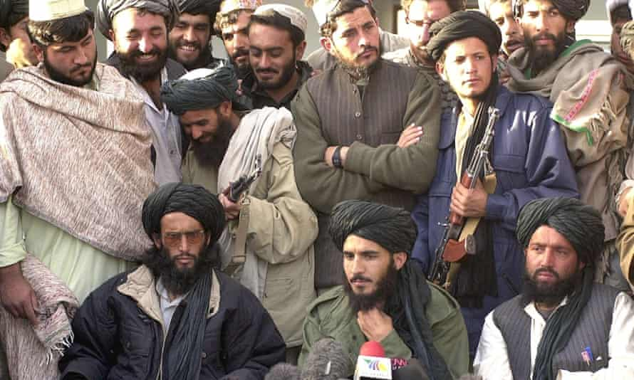 Mohammad Tayyab Agha, seated in the center, led an official delegation to Tehran this week. In this file photo, the special assistant to Mulla Mohammad Omar, addresses a press conference in Spin Boldak on 21 November 2001.