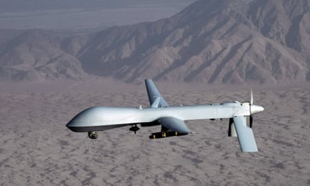 A US MQ-1 Predator unmanned aircraft in flight at an undisclosed location.