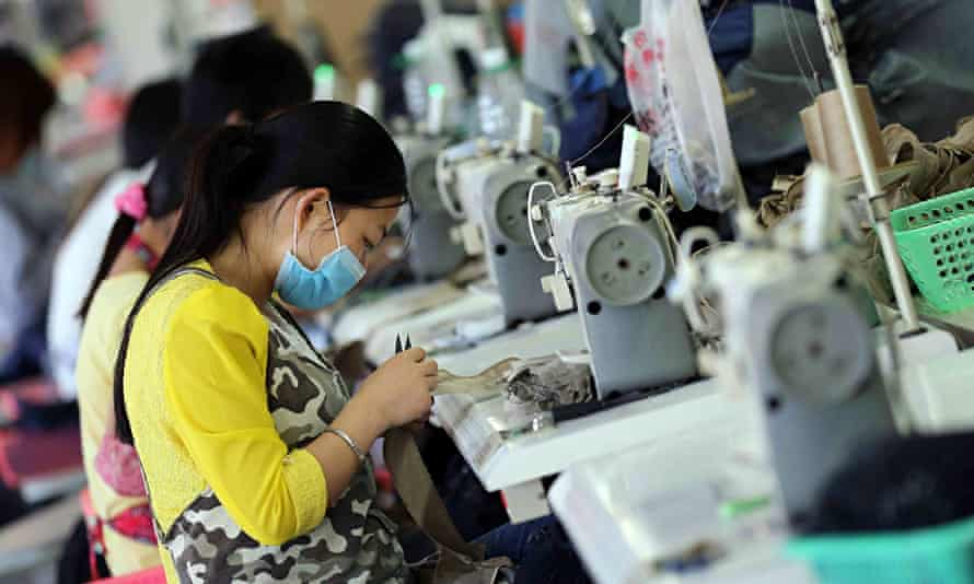 Workers making jeans in China
