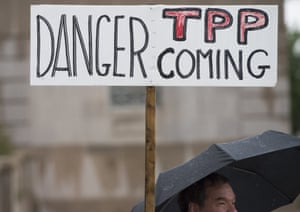 Demonstrators march in Washington DC to protest against the Trans-Pacific Partnership.