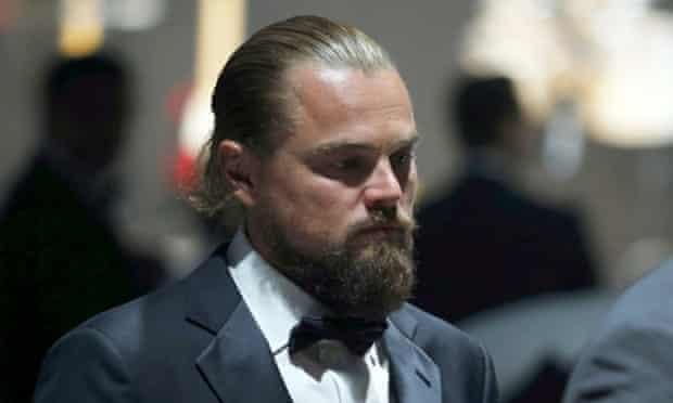 Leonardo DiCaprio walks during an auction at amfAR's Cinema Against AIDS 2015.