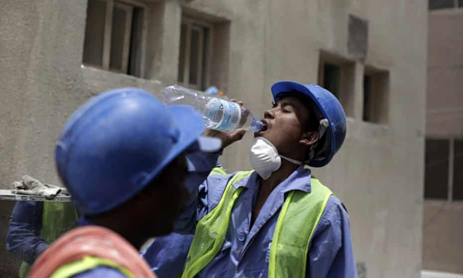 A Nepalese worker takes a break during a government-organised media tour of World Cup construction p