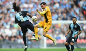Southend's David Worrall and Marcus Bean, of Wycombe, go toe to toe in the League Two play-off final at Wembley.