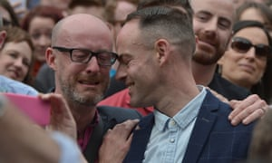 An emotional gay couple celebrate in Dublin Castle Square
