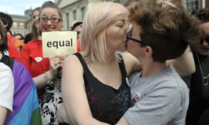 Two women kiss as people celebrate a landslide victory of a yes vote after a referendum on same-sex marriage was won by popular ballot vote by a margin of around two to one.