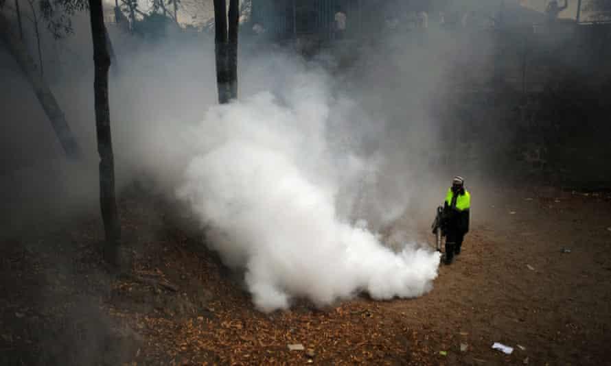 A municipal worker fumigates at Madreselva in San Salvador, El Salvador in 2013 after a dengue fever alert.